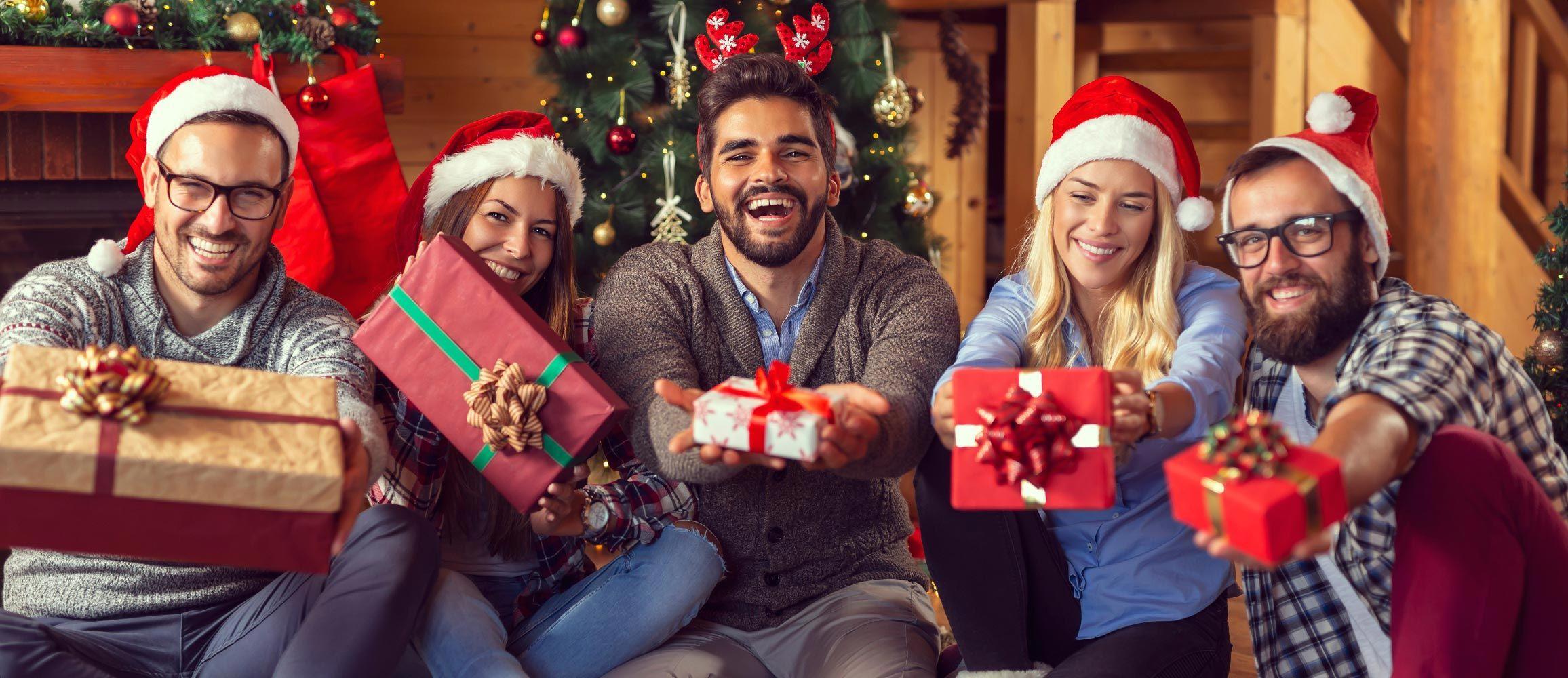 Group of friends celebrating Secret Santa